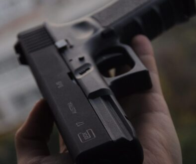 person holding black semi automatic pistol