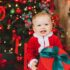 baby in red and white santa costume